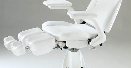 Pedicure chair in white imitation leather